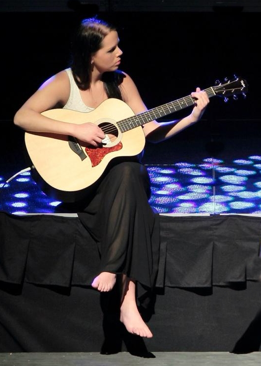 19 June 30 2014, Victoria playing guitar